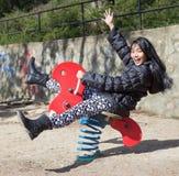Cheerful girl enjoying on the swing Stock Photos