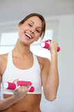 Cheerful girl exercising Stock Images