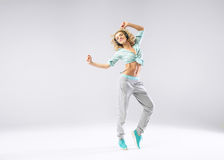 Cheerful girl exercising with music Stock Images
