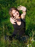 Cheerful girl in field royalty free stock photography