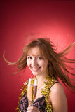 Cheerful girl with flying hair and champagne glass Stock Photos