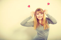 Cheerful girl fooling with hearts. Royalty Free Stock Photo