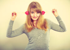 Cheerful girl fooling with hearts. Royalty Free Stock Photography