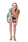 Cheerful girl in full growth in a flowered dress. Stock Photography