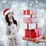 Cheerful girl get many christmas gift Stock Photo