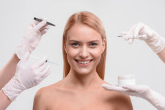 Cheerful Girl Getting Facial Skincare Treatment Royalty Free Stock Images