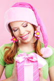 Cheerful girl with gift Royalty Free Stock Images
