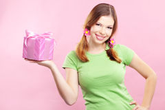 Cheerful girl with gift Stock Photos