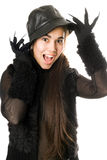 Cheerful girl in gloves with claws. Isolated Stock Images