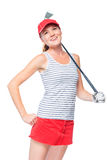 Cheerful girl with a golf club in a red cap and skirt on a white Royalty Free Stock Image