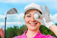 Cheerful girl on the golf course with equipment. Happy cheerful girl on the golf course with equipment Stock Photos