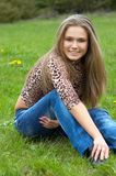 Cheerful girl on the grass Royalty Free Stock Photography