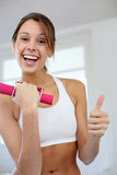 Cheerful girl at the gym Stock Photography
