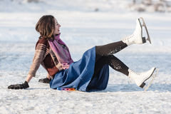 Cheerful girl having fun in winter ice skating. Royalty Free Stock Photography