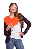 Cheerful girl with a heart in his hands Royalty Free Stock Photography
