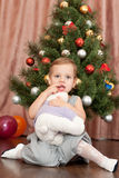 Cheerful girl with her christmas present Royalty Free Stock Images
