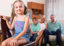 Cheerful girl with her family Stock Photography