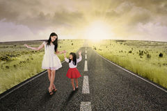 Cheerful girl and her mother on road Royalty Free Stock Photos