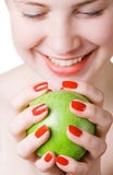Cheerful girl holding an apple Royalty Free Stock Photography