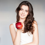 Cheerful girl holding apple Stock Photo