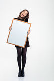 Cheerful girl holding blank board Royalty Free Stock Photography