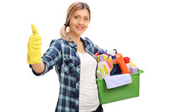 Cheerful girl holding cleaning products Stock Image