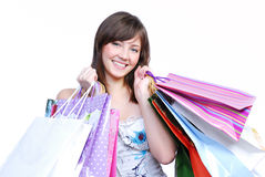 Cheerful girl holding colored bags Stock Photo