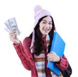 Cheerful girl holding folder and money Stock Image