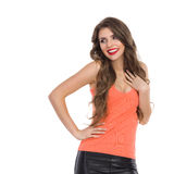 Cheerful Girl Holding Hand On Chest Royalty Free Stock Photography
