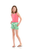Cheerful girl holding hands in pockets Royalty Free Stock Images