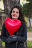 Cheerful girl holding the heart Royalty Free Stock Photos
