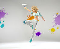 Cheerful girl holding a paint roller Stock Photo