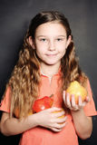 Cheerful Girl holding pears Royalty Free Stock Photo