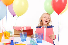 Cheerful girl holding present box Stock Images