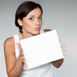 Cheerful girl holding sign Stock Image