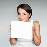 Cheerful girl holding sign Royalty Free Stock Photography