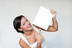 Cheerful girl holding sign Stock Photography