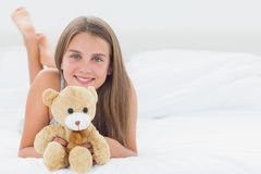 Cheerful girl holding a teddy bear Stock Image