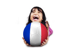 Cheerful girl holds ball with flag of France Royalty Free Stock Images