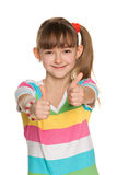 Cheerful girl holds her thumbs up Stock Image