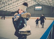 Cheerful girl on ice skating rink Stock Photo