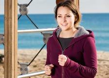 Cheerful girl jogging at seaside Royalty Free Stock Photos