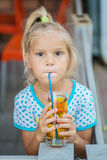 Cheerful girl juice drink Stock Images