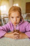 Cheerful girl juice drink Stock Photography