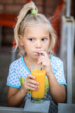 Cheerful girl juice drink Stock Photo