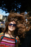 Cheerful girl in a jump. With flying hair stock photos