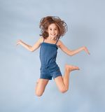 Cheerful girl jumping Royalty Free Stock Images