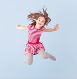Cheerful girl jumping Stock Image