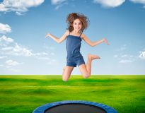 Cheerful girl jumping on a meadow Royalty Free Stock Photography