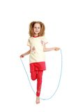 Cheerful girl jumping rope Stock Photos